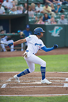 Ogden Raptors designated hitter Daniel Robinson (50) follows through on his swing during a Pioneer League game against the Great Falls Voyagers at Lindquist Field on August 23, 2018 in Ogden, Utah. The Ogden Raptors defeated the Great Falls Voyagers by a score of 8-7. (Zachary Lucy/Four Seam Images)