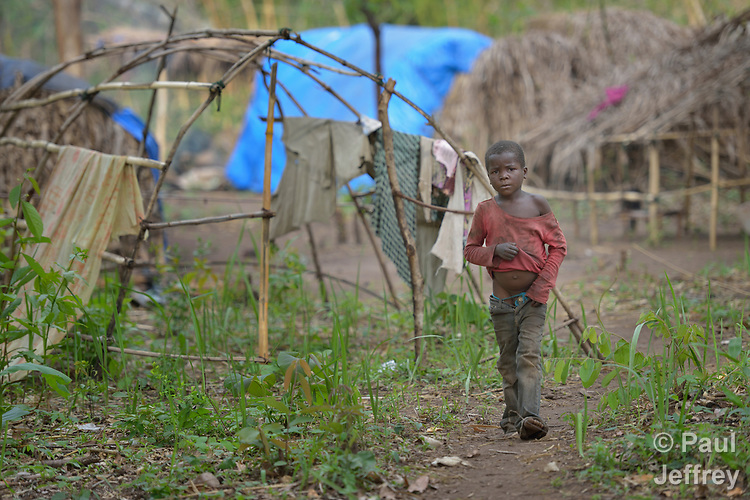 A boy walks through a camp for more than 5,000 displaced people in Riimenze, in South Sudan's Gbudwe State, what was formerly Western Equatoria. Families here were displaced at the beginning of 2017, as fighting between government soldiers and rebels escalated.<br />