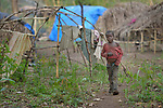 A boy walks through a camp for more than 5,000 displaced people in Riimenze, in South Sudan's Gbudwe State, what was formerly Western Equatoria. Families here were displaced at the beginning of 2017, as fighting between government soldiers and rebels escalated.<br /> <br /> Two Catholic groups, Caritas Austria and Solidarity with South Sudan, have played key roles in assuring that the displaced families here have food, shelter and water.<br /> The camp formed around the Catholic Church in Riimenze as people fled violence in nearby villages for what they perceived as the safety offered by the church.