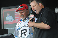 NWA Democrat-Gazette/FLIP PUTTHOFF <br /> Darrel Robertson of Jay, Okla., (left) watches the scale Saturday April 16, 2016 with weigh-in emcee Chris Jones. Robertson is in second place going into today's final round.
