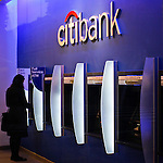A woman uses a ATM machine at one Citibank branch in New York. 16/10/2012. The Board of Directors of Citigroup announced that Vikram Pandit has stepped down as the Company's CEO and it has unanimously elected Michael Corbat as new CEO and a director of the Board. Photo by Eduardo Munoz Alvarez / VIEWpress.