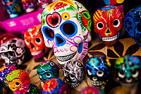 Colorful hand painted skulls are sold on the market during the Day of the Dead festivities in Mexico City, Mexico, 28 October 2016. Skulls, skeletons and the other death symbols are used to adorn graves, altars and offerings during the Day of the Dead (Día de Muertos). A syncretic religious holiday, combining the death veneration rituals of the ancient Aztec culture with the Catholic practice, is celebrated throughout all Mexico. Based on the belief that the souls of the departed may come back to this world on that day, people gather at the gravesites in cemeteries, praying, drinking and playing music, to joyfully remember friends or family members who have died and to support their souls on the spiritual journey.