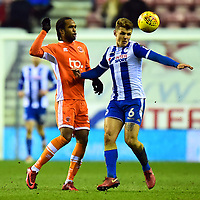 Wigan Athletic's Max Power competes with Blackpool's Nathan Delfouneso<br /> <br /> Photographer Richard Martin-Roberts/CameraSport<br /> <br /> The EFL Sky Bet League One - Wigan Athletic v Blackpool - Tuesday 13th February 2018 - DW Stadium - Wigan<br /> <br /> World Copyright &copy; 2018 CameraSport. All rights reserved. 43 Linden Ave. Countesthorpe. Leicester. England. LE8 5PG - Tel: +44 (0) 116 277 4147 - admin@camerasport.com - www.camerasport.com