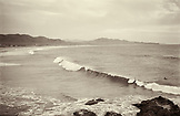 MEXICO, Baja, Cerritos Beach, surfers and a breaking wave (B&W)