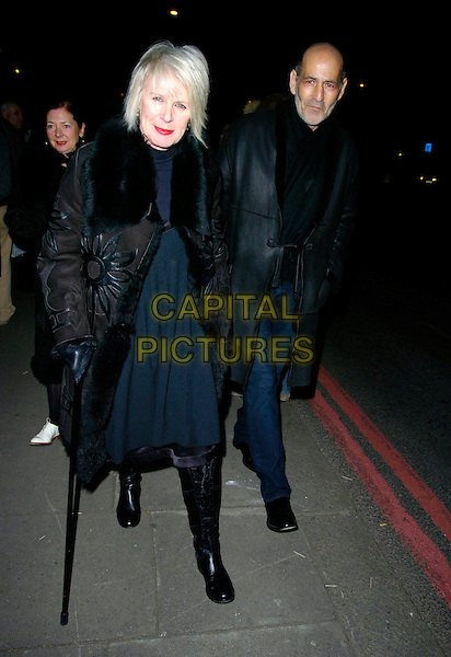 BETTY JACKSON & GUEST.Arrives for a VIP private view of Kylie - The Exhibition at the Victoria & Albert (V&A) Museum, London,.England, February 6th 2007..full length black coat boots fur collar.CAP/CAN.©Can Nguyen/Capital Pictures