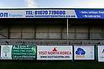 A 'Visit North Korea' advertisement at Croft Park. Blyth Spartans v Brackley Town, 30112019. Croft Park, National League North. Photo by Paul Thompson.