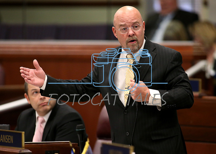 Nevada Assemblyman Ira Hansen, R-Sparks, speaks on the Assembly floor at the Legislative Building in Carson City, Nev., on Tuesday, Feb. 17, 2015. Hansen spoke in support of a construction defect bill that passed the Assembly on a 25-17 party-line vote Tuesday. <br /> Photo by Cathleen Allison