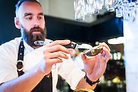 Chef Johan Malm shows off how to properly shuck a Grebbestad-sourced oyster.