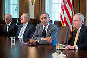 United States President Barack Obama holds a meeting with members of Congress on foreign policy on Thursday, July 31, 2014. The U.S. might move to limit derivatives trading and short-term loans with Russian companies if sanctions already imposed fail to sway President Vladimir Putin of Russia to end support for rebels in eastern Ukraine. From left to right: U.S. Senator Bob Corker (Republican of Tennessee), Senator Reid, President Obama, and U.S. Senate Republican Leader Mitch McConnell (Republican of Kentucky).<br /> Credit: Andrew Harrer / Pool via CNP