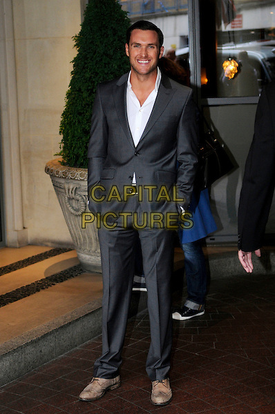 OWAIN YEOMAN.Spotted leaving his hotel in Central London, England..June 1st 2011.full length grey gray suit white shirt hands in pockets brown shoes .CAP/IA.©Ian Allis/Capital Pictures.