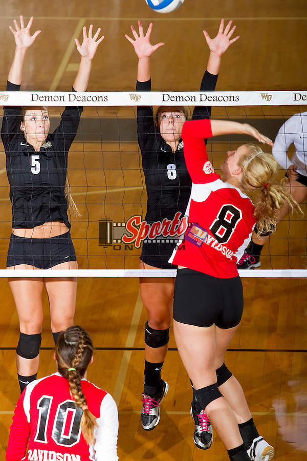 Kristin Grissom (5) and Kylie Hargreaves (8) of the Wake Forest Demon Deacons attempt to block the ball during the match against the Davidson Wildcats in Reynolds Gymnasium on September 1, 2012 in Wake Forest, North Carolina.  The Demon Deacons defeated the Wildcats 3-2.   (Brian Westerholt / Sports On Film)