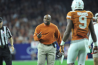 NWA Media/Michael Woods --12/29/2014-- w @NWAMICHAELW...University of Texas coach Charlie Strong reacts to a call in the 1st quarter against the Razorbacks during the Texas Bowl Monday night at  NRG Stadium in Houston.