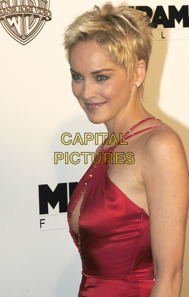 SHARON STONE.arrivals at  amfAR 's Cinema Against Aids 2004.at Le Moulin de Mougins .Cannes Film Festival, France 20 May 2004..half length long strappy red satin dress revealing cut out away .sales@capitalpictures.com.www.capitalpictures.com.©Capital Pictures