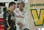 Veteran NASCAR drivers Joe Nemecheck, left, and Sterling Marlin, right, share a moment in the garage area at Daytona International Speedway in Daytona Beach, Fla., during NASCAR Nextel Cup testing, Wednesday, January 18, 2006.(AP Photo/Brian Myrick)