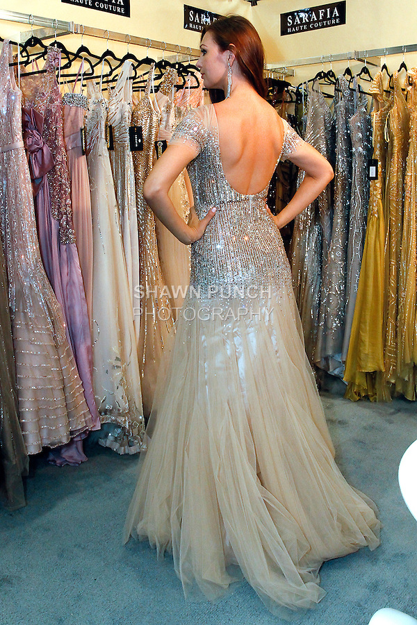 Model poses in Sarafia Haute Couture gown at the Coterie 2013 trade show presented by ENK International, at the Javits Center on September 18, 2013.