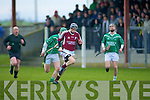 Adam Harty (causeway) solos the ball as Eric O'Connor and Jason Bowler )(ballyduff) give chase), in the Acorn Life under 21 County Hurling Championship on Saturday at Kilmoyley.............................. ..........