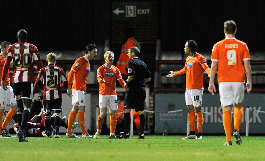 Blackpool's Charles Dunne is shown a red card by referee Andy D'Urso<br /> <br /> Photographer Ashley Western/CameraSport<br /> <br /> Football - The Football League Sky Bet League One - Brentford v Blackpool - Tuesday 24th February 2015 - Griffin Park - London<br /> <br /> &copy; CameraSport - 43 Linden Ave. Countesthorpe. Leicester. England. LE8 5PG - Tel: +44 (0) 116 277 4147 - admin@camerasport.com - www.camerasport.com