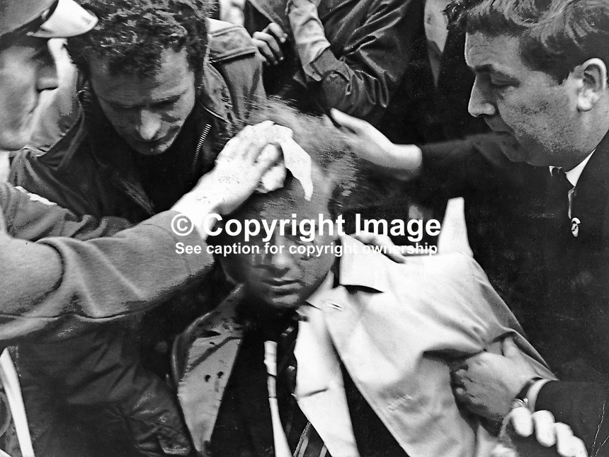 Ivan Cooper, Derry Citizen's Action Committee, DCAC, is tended by John Hume (right) after being injured in clashes which followed an Apprentice Boys of Derry parade in Londonderry on 12th August 1969. Just a year later both John Hume and Ivan Cooper along with Gerry Fitt were founder members of the SDLP, Social Democratic &amp; Labour Party. 1969081201a<br />