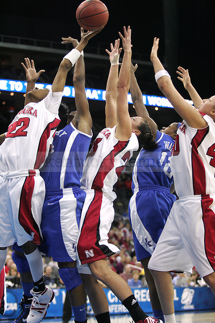 No. 4 UK Women's Hoops and No. 1 Nebraska fight for the ball during the second half of their game on Sunday, March 28, 2010 at the Women's Sweet 16 Tournament in Kansas City, Mo. The Cats defeated the Huskers 76-67, sending the Cats to the Elite 8 for the first time in Kentucky history. Photo by Allie Garza | Staff