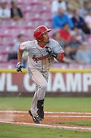 Luke Tendler #17 of the Spokane Indians runs to first base during a game against the Salem-Keizer Volcanoes at Volcanoes Stadium on July 26, 2014 in Keizer, Oregon. Spokane defeated Salem Keizer, 4-1. (Larry Goren/Four Seam Images)
