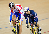 07 DEC 2014 - STRATFORD, LONDON, GBR - Michael d'Almeida (FRA) from France looks for an opportunity to   attack during his 1/16 final against Nikita Shurshin (RUS) (left) from Russia in the men's Individual Sprint at the 2014 UCI Track Cycling World Cup in the Lee Valley Velo Park in Stratford, London, Great Britain (PHOTO COPYRIGHT © 2014 NIGEL FARROW, ALL RIGHTS RESERVED)