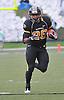 Nov 13, 2010; Columbia, MO, USA; Missouri Tigers running back De'Vion Moore (26) runs for yardage as Kansas State Wildcats cornerback Tysyn Hartman (2) attempts coverage in the second half at Memorial Stadium. Missouri won 38-28.  Mandatory Credit: Denny Medley-US PRESSWIRE