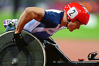 PICTURE BY ALEX BROADWAY /SWPIX.COM - 2012 London Paralympic Games - Day Four - Athletics, Olympic Stadium, Olympic Park, London, England - 02/09/12 - David Weir of Great Britain competes in the Men's 5000m T54 Final.