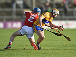 Conor Mc Grath of Clare in action against Conor O Sullivan of Cork during their Munster Hurling League game at Cusack Park. Photograph by John Kelly.