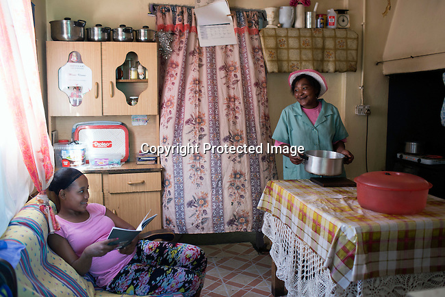 CAPE TOWN, SOUTH AFRICA - NOVEMBER 19: Cornelia Klaase a farmworker at a wine farm, speak to her daughter in the kitchen on November 19, 2015 in in Boland area outside of Cape Town, South Africa.  (Photo by: Per-Anders Pettersson)