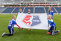 Bridgeview, IL, USA - Sunday, May 1, 2016: Flag bearers present the NWSL flag before a regular season National Women's Soccer League match between the Chicago Red Stars and the Orlando Pride at Toyota Park. Chicago won 1-0.
