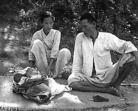 A refugee family from Ching Pung Men near Masan, now living in a refugee camp at Changseung-po, Korea.  October 1950. United Nations. (USIA)<br /> Exact Date Shot Unknown<br /> NARA FILE #:  306-PS-51-17008<br /> WAR &amp; CONFLICT BOOK #:  1481