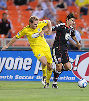 DC United forward Pablo Hernandez (21) fights for possession of the ball against Columbus Crew defender Chad Marshall (14)  The Columbus Crew defeated DC United 1-0 at RFK Stadium, Saturday September 4, 2010.