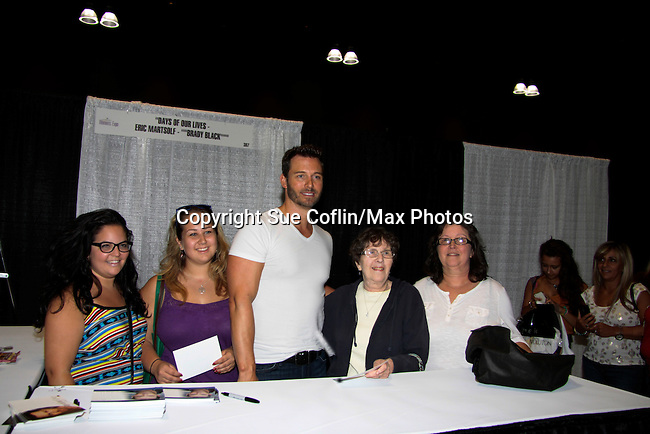 """Days of Our Lives Eric Martsolf """"Brady Black"""" with fans as he appears at the 12th Annual Comcast Women's Expo on September 7 (also 6th), 2014 at the Connecticut Convention Center, Hartford, CT. He signed photos, posed with fans, walked the runway with models from Kathy Faber Designs Fashion Show, and broke some boards at Villari's Martial Arts Centers booth with Maggie and Ryan Farley.  (Photo by Sue Coflin/Max Photos)"""