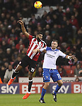 Ethan Ebanks-landell of Sheffield United and Tom Pope of Bury tussle in the air during the English Football League One match at Bramall Lane, Sheffield. Picture date: November 22nd, 2016. Pic Jamie Tyerman/Sportimage