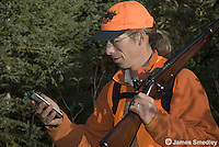 Hunter checking his location on a gps