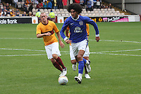 Marouane Fellaini gets away from Nicky Law in the Motherwell v Everton friendly match at Fir Park, Motherwell on 21.7.12 for Steven Hammell's Testimonial.
