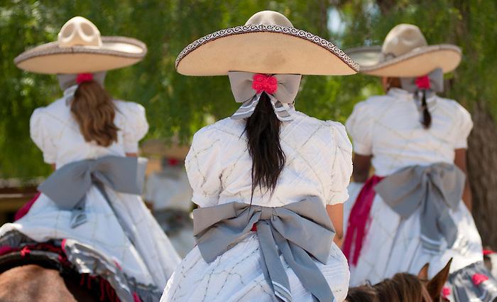 Escaramuzas prepare to perform during the Fiesta Charreada, Sunday, April 22, 2012, in San Antonio. (Darren Abate/pressphotointl.com)