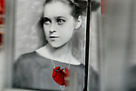 Retro image of a young woman with a red heart