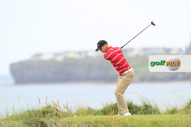 Conor O'Rourke (Naas) on the 12th tee during the Quarter Finals of The South of Ireland in Lahinch Golf Club on Tuesday 29th July 2014.<br /> Picture:  Thos Caffrey / www.golffile.ie