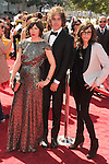 LOS ANGELES, CA - SEPTEMBER 15: Carrie Brownstein, Jonathan Krisel and Mary Timony arrive at the 2012 Primetime Creative Arts Emmy Awards at Nokia Theatre L.A. Live on September 15, 2012 in Los Angeles, California.
