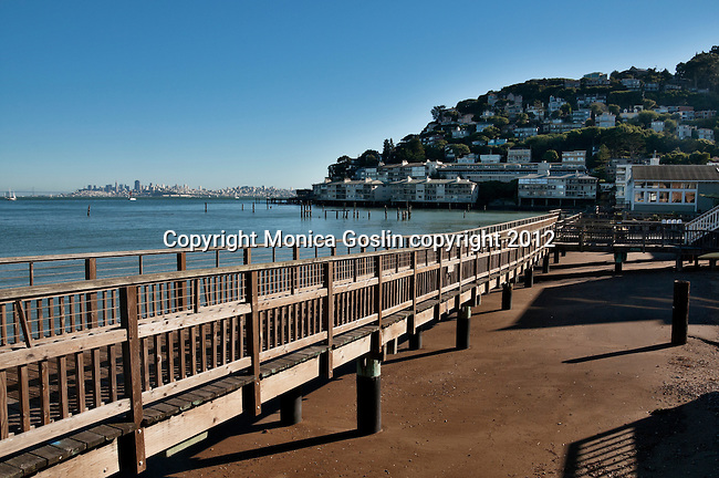San Francisco, California skyline in the distance with Sausalito beach houses in the foreground