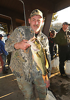 NWA Democrat-Gazette/FLIP PUTTHOFF<br /> Shane Spiva shows a 4.92-pound largemouth bass that anchored thesecond-place for he and Don Woolsey on Friday Jan. 1, 2016 in the Polar Bear Bass Tournament at Beaver Lake.