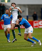 Photo: Richard Lane/Richard Lane Photography. Ireland U20 v Italy U20. Semi Final. 18/06/2008. Ireland's Niall Morris is tackled by Italy's Roberto Quartaroli.