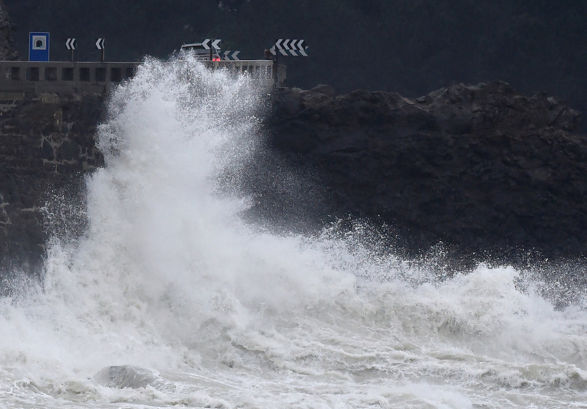 A picture taken on February 10, 2016 shows waves hitting a retaining wall in the Basque village of Zumaia. Alerts have been issued for dangerous waves along the Basque coast. PHOTO/ ANDER GILLENEA