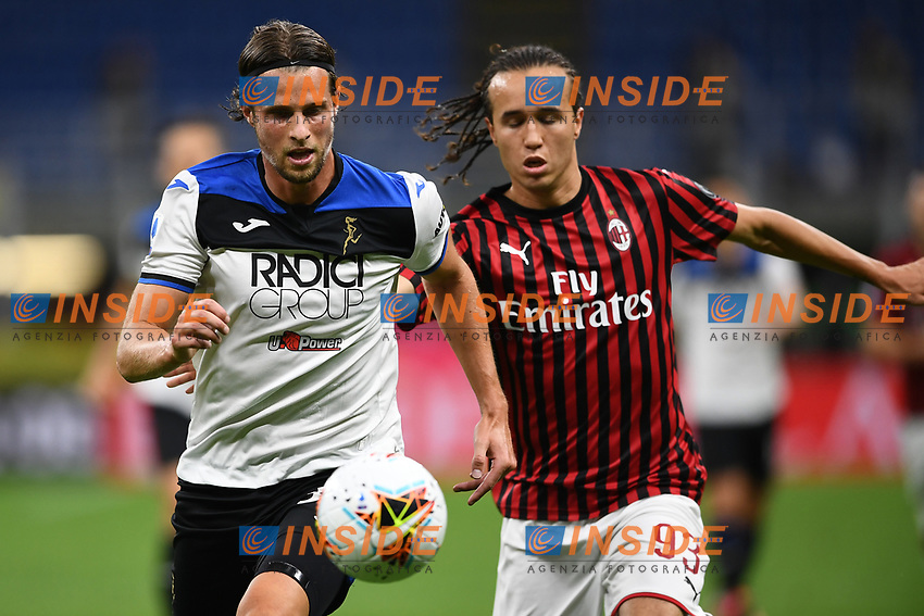 Hans Hateboer of Atalanta BC and Diego Laxalt of AC Milan compete for the ball during the Serie A football match between AC Milan and Atalanta BC at stadio Giuseppe Meazza in Milano ( Italy ), July 24th, 2020. Play resumes behind closed doors following the outbreak of the coronavirus disease. <br /> Photo Image Sport / Insidefoto