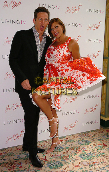 "MATTHEW WRIGHT & JADE GOODY.STOCK PHOTO: Jade Goody found fame in Big Brother 3 (2002) and has since been a target of ridicule in the British tabloid press. She was diagnosed with cervical cancer in August 2008 which then spread to her liver, bowel & groin. Doctors have confirmed reports that she only has months to live. She is now making plans for the future care of her 2 sons, Freddie & Bobby Jack that she had with her previous partner, Jeff Brazier. She will marry her present partner, Jack Tweed, within two weeks..Photocall at the Dorchester for her new reality show ""Just Jade"", London, UK..Msy 24th, 2006.Ref: CAN.full length orange white floral print dress ribbon red.www.capitalpictures.com.sales@capitalpictures.com.©Capital Pictures"