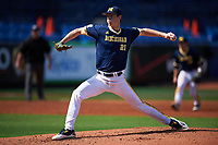 Michigan Wolverines starting pitcher Evan Hill (21) delivers a pitch during the second game of a doubleheader against the Canisius College Golden Griffins on February 20, 2016 at Tradition Field in St. Lucie, Florida.  Michigan defeated Canisius 3-0.  (Mike Janes/Four Seam Images)