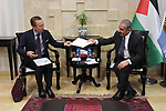 Palestinian Prime Minister Mohammad Ishtayeh meets with Japan Ambassador for Palestine Takeshi Okubo, in the West Bank city of Ramallah, June 18, 2019. Photo by Prime Minister Office