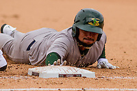 Beloit Snappers infielder Jesus Lopez (7) dives back to first during a Midwest League game against the Wisconsin Timber Rattlers on April 10th, 2016 at Fox Cities Stadium in Appleton, Wisconsin.  Wisconsin defeated Beloit  4-2. (Brad Krause/Four Seam Images)