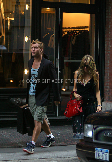 ** EXCLUSIVE ** FEE MUST BE AGREED BEFORE USE **..Minutes after Jude Law and his girlfriend, Sienna Miller, arrived to New York from London, they went on a shopping spree in SoHo. The happy couple was seen walking around holding hands and talking to each other. They were seen going into several boutiques, including 'A Store' where JUDE bought a few jackets. Later Jude and Sienna were seen shopping at 'Duane Reid' Pharmacy Store. New York, June 7, 2004. Please byline: BRIAN FLANNERY/ACE Pictures.   ..  *** ***..All Celebrity Entertainment, Inc:  ..contact: Alecsey Boldeskul (646) 267-6913 ..Philip Vaughan (646) 769-0430..e-mail: info@nyphotopress.com